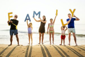 SEL Programs - Family holding up the word family
