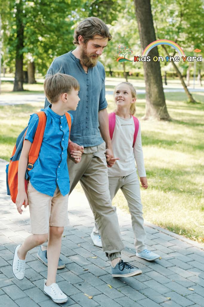 Father walking kids to school