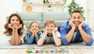 Portrait Of Cheerful Family With Two Kids Posing At Home